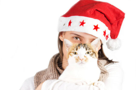 girl with Santa s hat with a cat in her arms on a white background photo