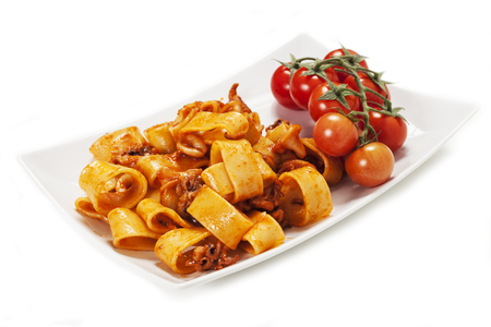 sauced pasta with squid on the white background Stock Photo