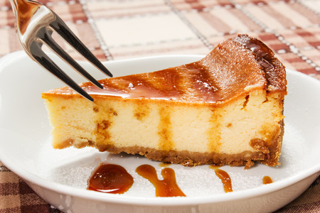 cheesecake with caramel sauce on the table photo