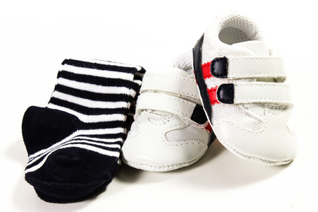 baby tennis shoes on the white background