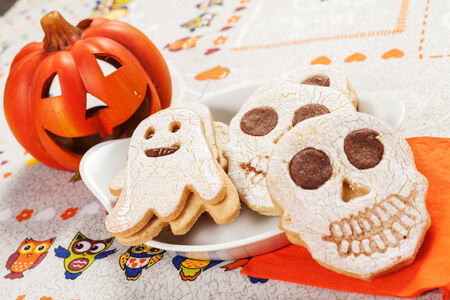 halloween cookies in the shape of ghost and skull photo