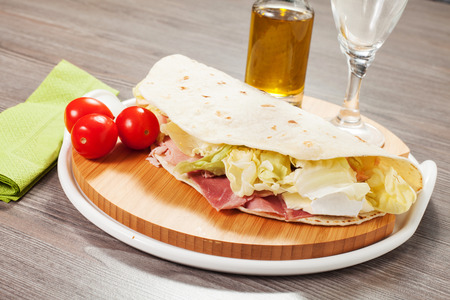 Traditional Italian flat bread on the table photo
