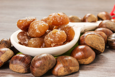 glace: Chestnuts and marron glace over a light brown background
