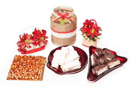 Christmas table with nuts,  nougat white, chocolate nougat, almond photo