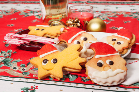 christmas biscuitsin the shape of santa claus and star on the table decorated photo