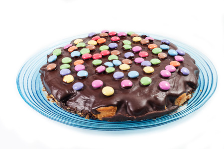 chocolate cake with smarties on the white background Stock Photo