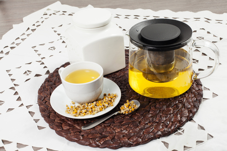 chamomile tea: chamomile tea with chamomile flower on the wooden table