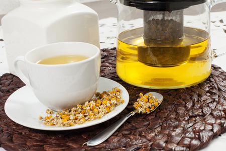 chamomile tea with chamomile flower on the wooden table
