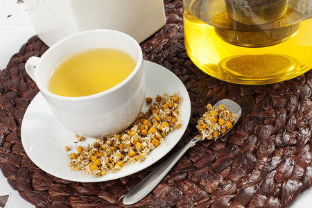 chamomile flower: chamomile tea with chamomile flower on the wooden table