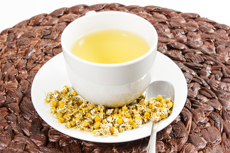 chamomile tea: Chamomile tea with chamomile flower on the white background