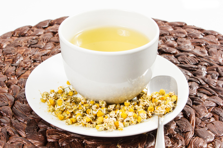 Chamomile tea with chamomile flower on the white background