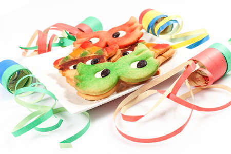 carnival cookies on the white background with confetti and streamers