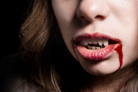 Vampire with the bloody teeth photo