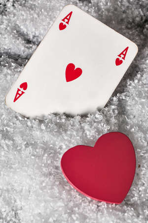 ace of hearts: Red heart with ace of hearts in the snow