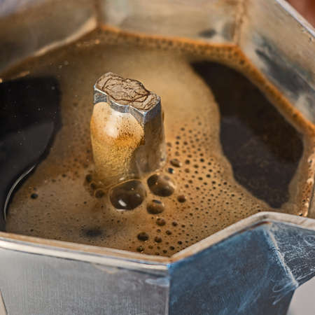 stovetop: The coffee is emerging from the mocha Stock Photo