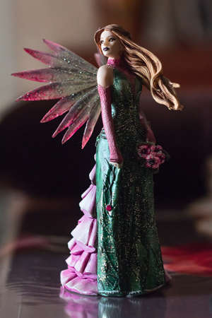 wood nymph: Toy fairy with wings and flowing hair Stock Photo