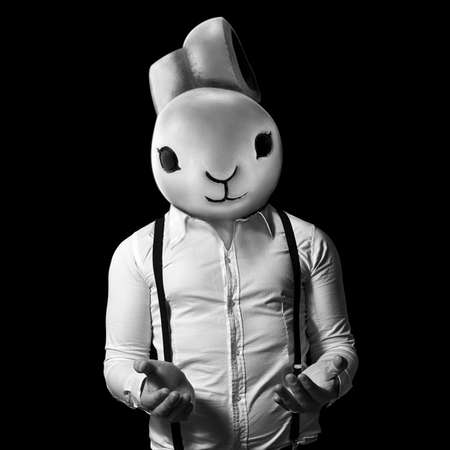 empty handed: man with bunny head and hands outstretched in black and white