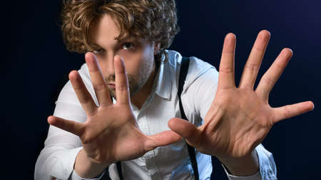 illusionist: image of a man who performs magic with his hands Stock Photo