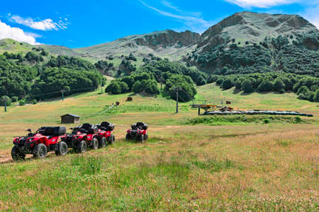 quad: landscape of mountain with quad bike Stock Photo