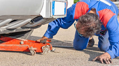 mechanician: mechanician work under a car Stock Photo