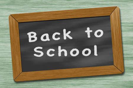 antique sleigh: white writing on the blackboard on school desk Stock Photo