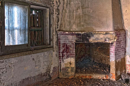fireplace: image of an old abandoned room with fireplace and window