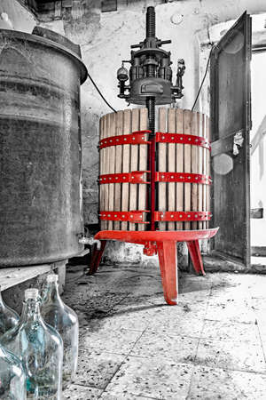 image of red wine press in black and white background