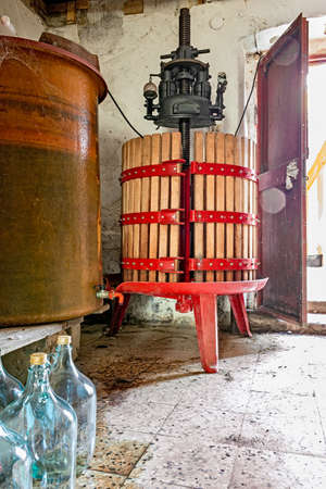 winepress: image of old red wine press