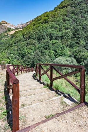 lucania: wooden staircase in the woods under a hill