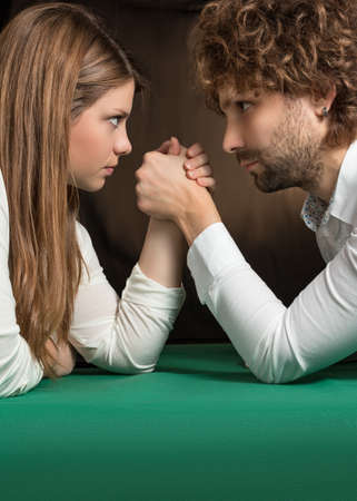 challenging sex: challenge of arm wrestling between man and woman