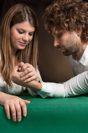 challenging sex: woman beats man to challenge of arm wrestling
