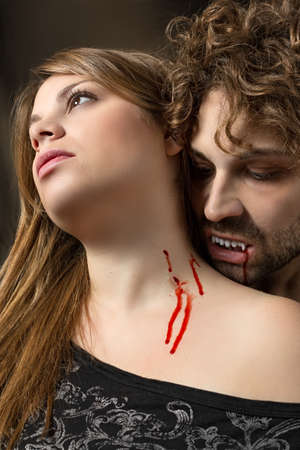 wolf couple: girl bitten by a vampire with bloody mouth