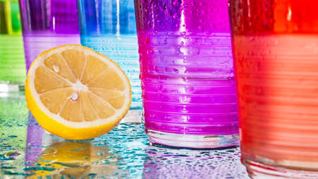 sopping: wet glasses colored with a lemon Stock Photo