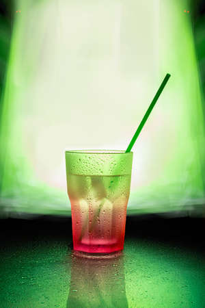 sopping: wet pink glass with green straw