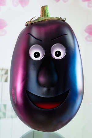 the human face: aubergine with human face