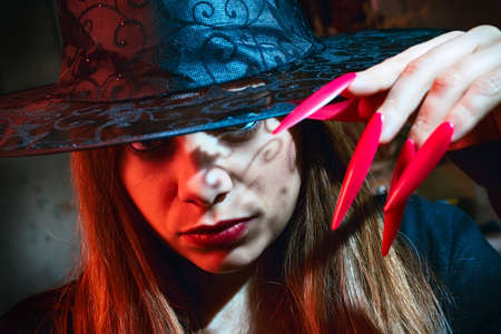 witch with red nails