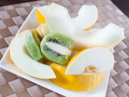 fresh fruit kiwi and yellow melon Stock Photo - 13602710