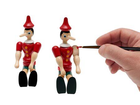 artist paints a puppet