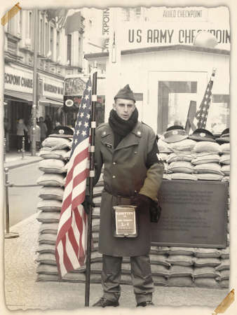 phonetic: BERLIN,GERMANY- NOVEMBER 18: The definition of Checkpoint Charlie emerged from the NATO phonetic August 13, 2000 it was opened a faithful reconstruction, in a short time become a great tourist attraction. on18,2012 in Berlin-Germany Editorial