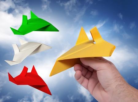aeronautics: hand hold paper airplane in the sky