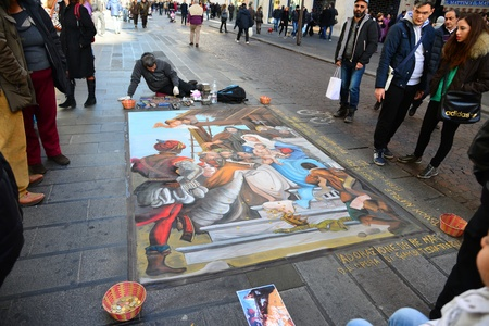 indigent: NAPLES, ITALY-DECEMBER 25: in the center of the latest madonnari paint the sidewalks of the city on December 25.2012 in Naples-Italy