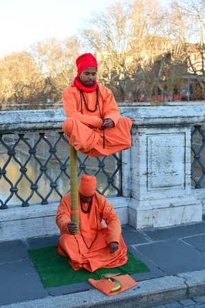 deceit: ROME -DECEMBER 28:suggestive fakirs surprised passers by with the levitation on December 28,2012 in Rome-Italy