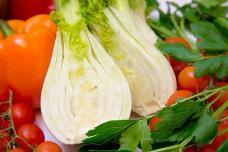 fresh vegetables with peppers, tomatoes and parsley photo