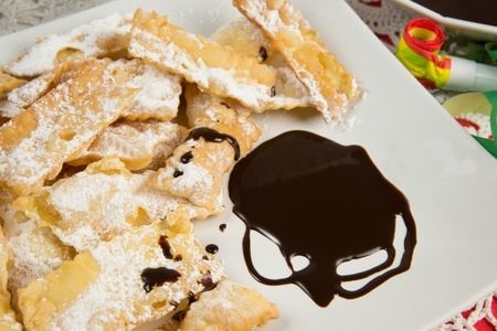 chiacchiere, italian fried carnival cookies with icing sugar Stock Photo - 17878915