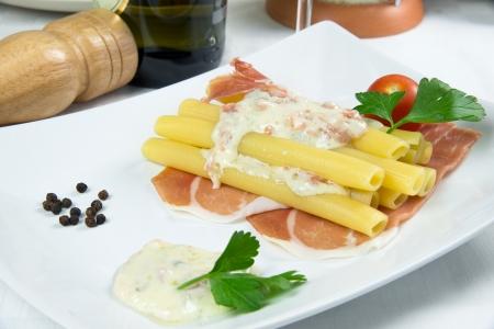 mascarpone:  Candele  with gorgonzola,mascarpone and ham Stock Photo