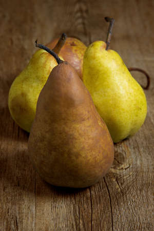 william and abate pears on wooden table Stock Photo - 18274247