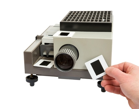 hand inserting slide in oldest  model  projector photo