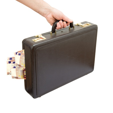 hand keeping suitcase content euro banknotes isolated