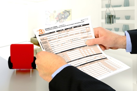 tax return: business consultant checks the tax forms of tax return