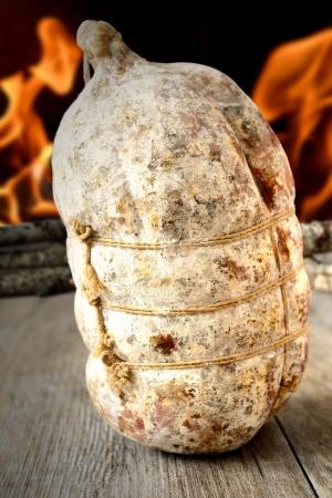 sacked: specialty sacked seasoned soppressata of fragrant wooden table